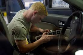 A man Sound deadening a car door