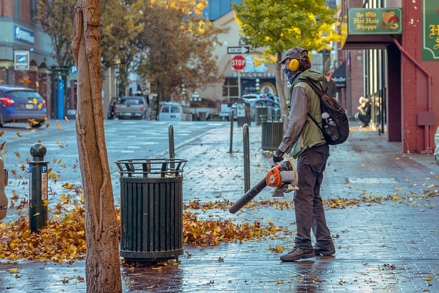 a man using a noiseless leaf blower