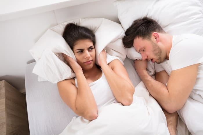 blocking out a snoring partner